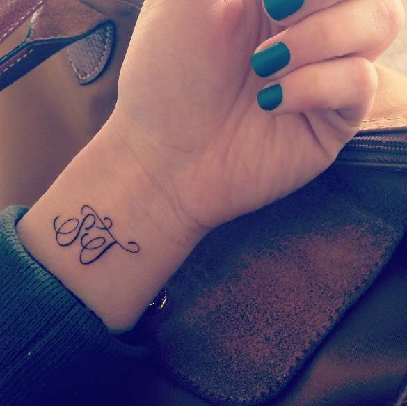 INITIAL WRIST TATTOO tattoo