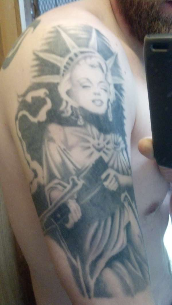 Marilyn Monroe with gun tattoo