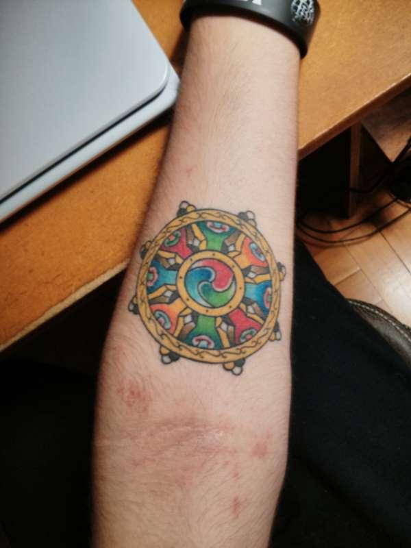 Wheel of Dharma tattoo