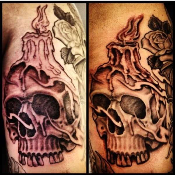 Skull with melting candle tattoo