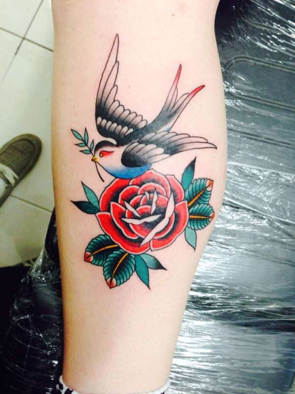 swallow with olive branch and rose tattoo