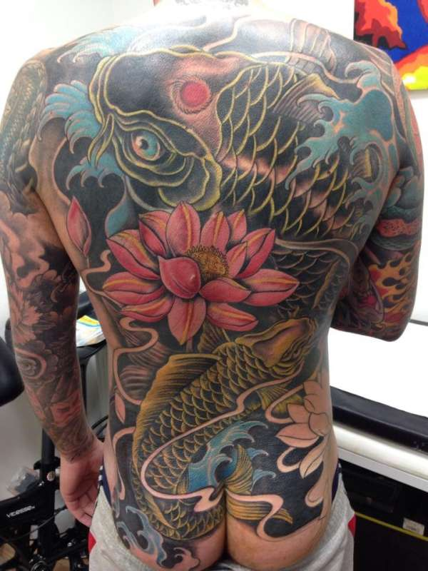 Koi back piece tattoo
