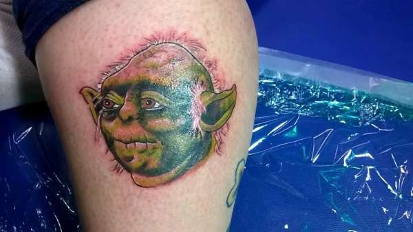 Irene's calf Yoda tattoo