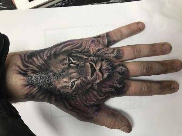 Lion hand tattoo for Finger lion tattoo