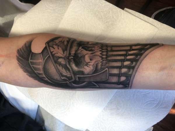 Roman death head tattoo