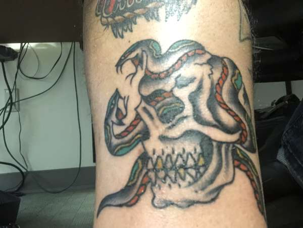 Skull with Snakes tattoo