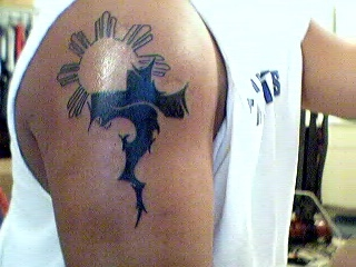 Tribal Cross & Sun tattoo