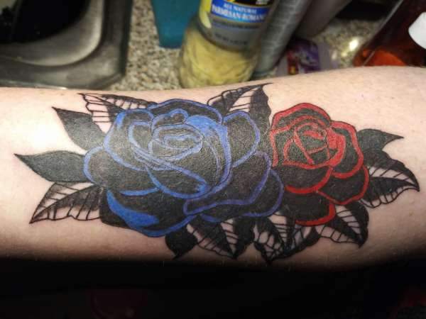 COVER UP OLD NAME TAT WITH ROSES tattoo