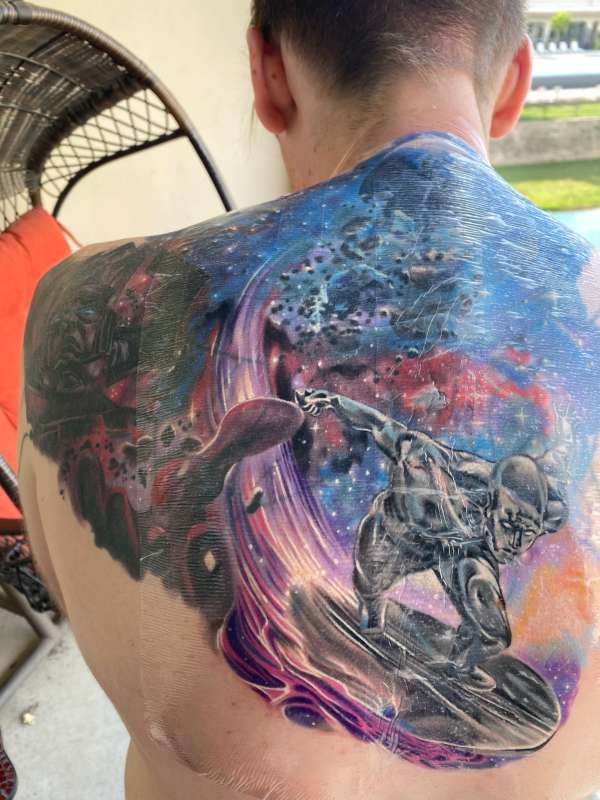 Silver Surfer and Galactus tattoo