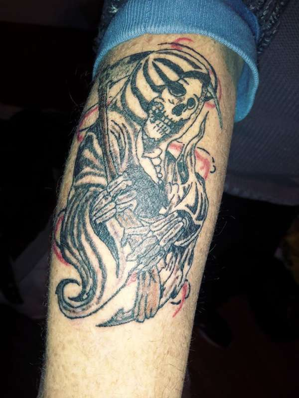 grim reaper by santa clause!!!!! tattoo