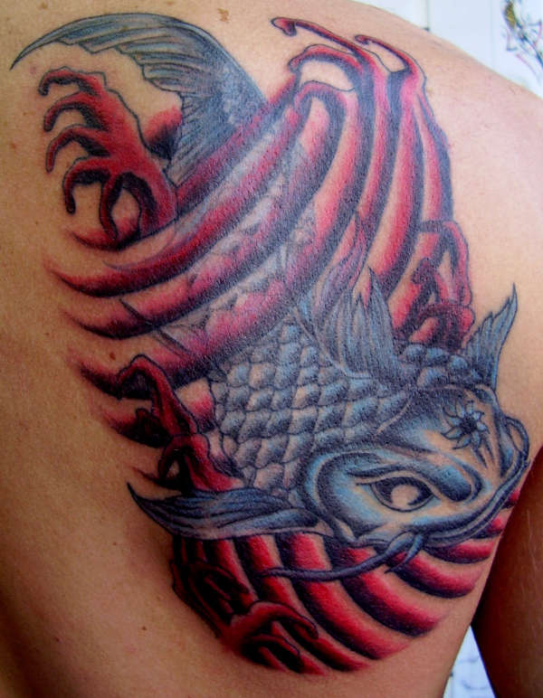 coil fish tattoo