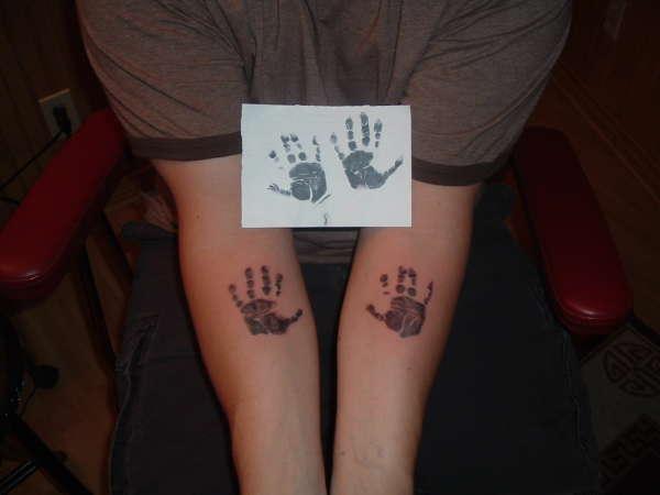 babies hands tattoo
