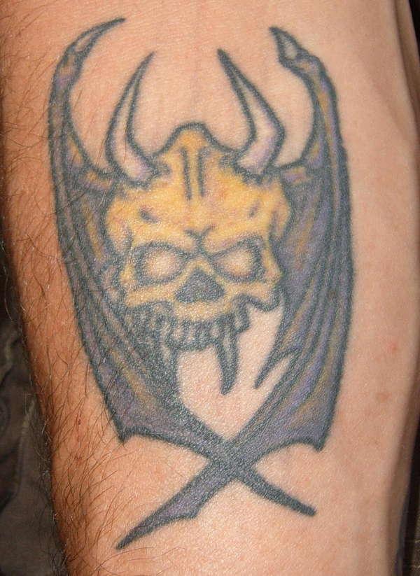 bat/skull tattoo