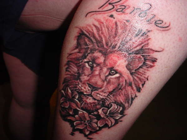 Lion in the lillies tattoo