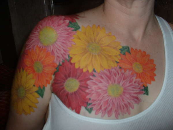 Arm/Chest flowers tattoo