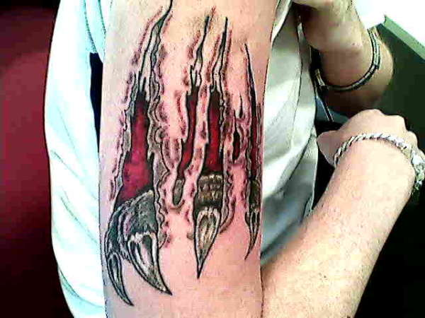 CLAW SCRAPES tattoo
