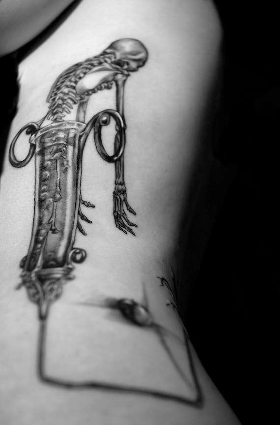 skeleton/syringe/dead tree tattoo