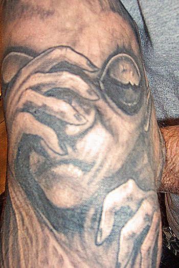 Black and Gray Alien tattoo
