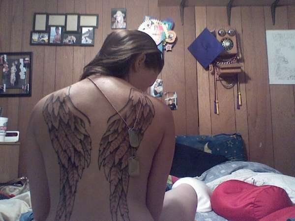 diff shots of wings tattoo