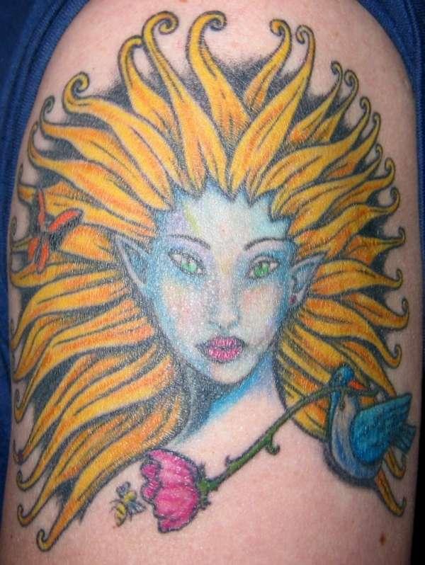 elf with bird tattoo