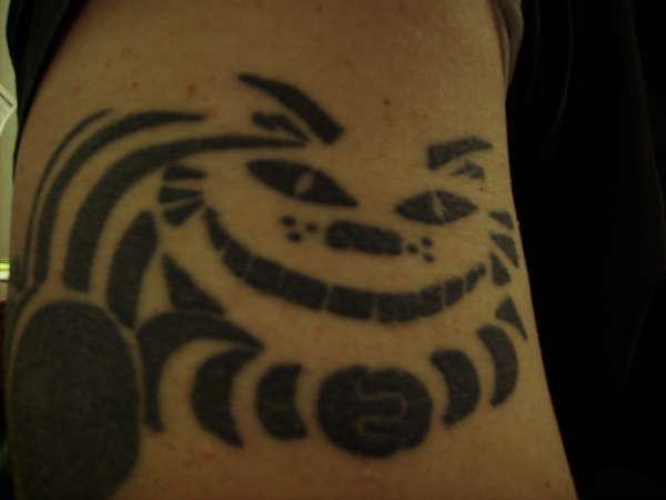 Tribal Cheshire Cat tattoo