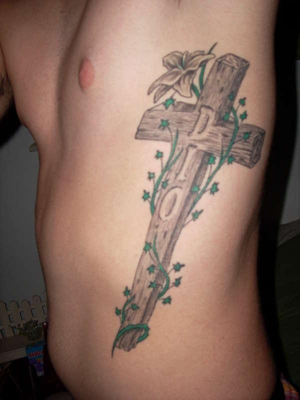 Cross on Left Side tattoo