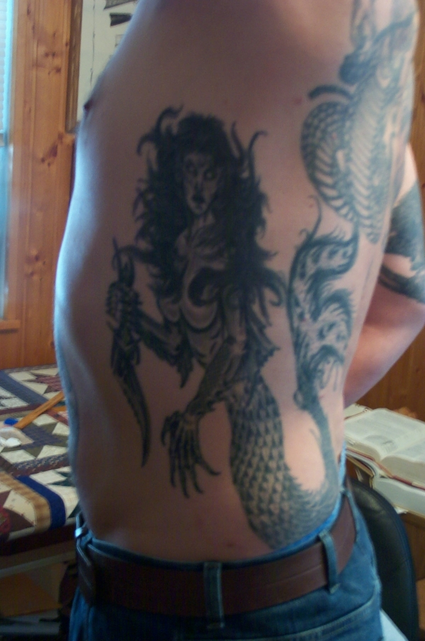 evil mermaid tattoo