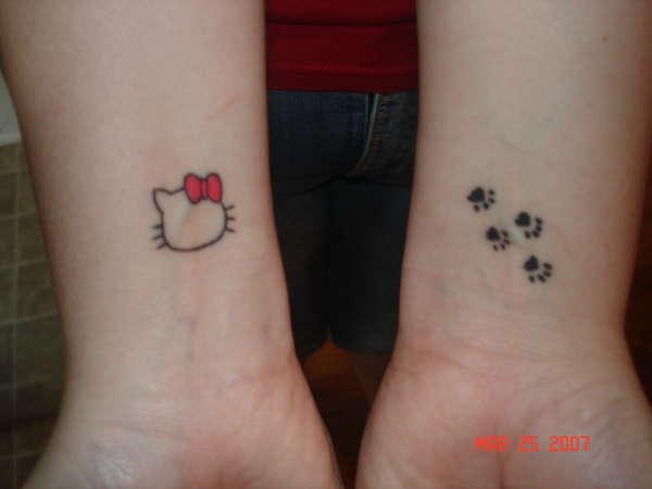 Paw prints & Hello Kitty tattoo