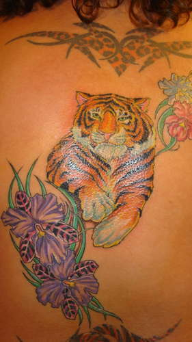 Tiger and hibiscus tattoo
