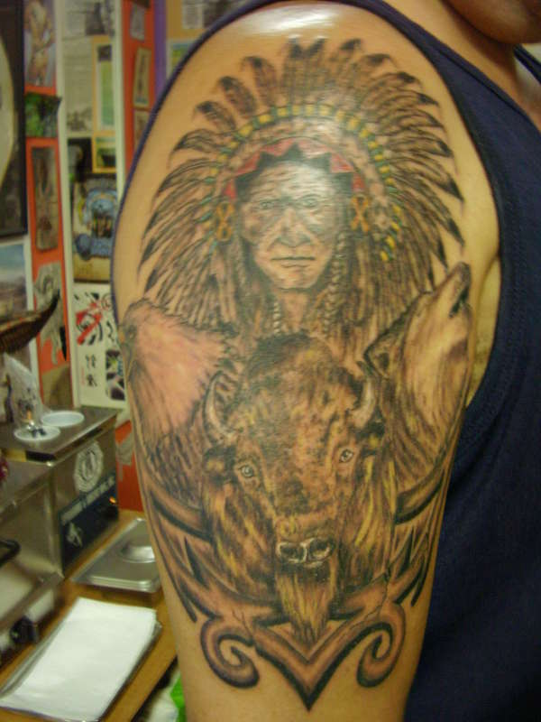 indian chief with eagle,wolf and buffalo tattoo