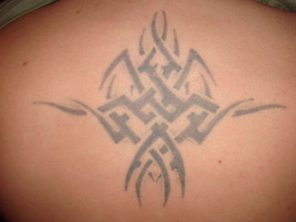 Top centre of back - Needs re-coulour tattoo