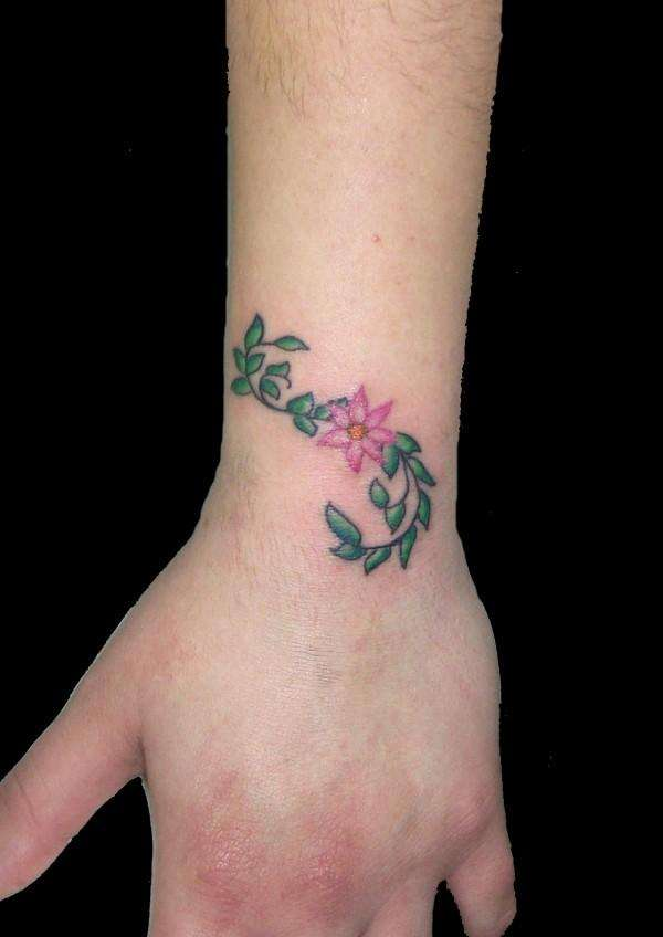 Flower on lower arm tattoo for Flower tattoos on lower arm