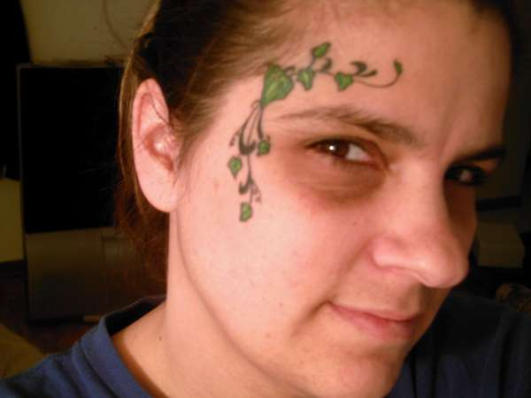 ivy on face tattoo