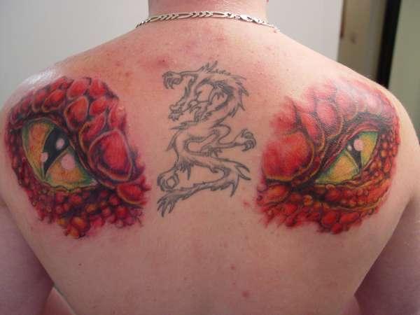 red dragon eyes tattoo