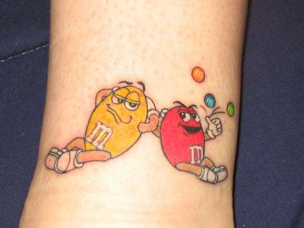 Red and Yellow m&m tattoo