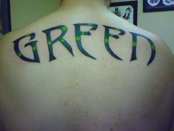 Last name on my back tattoo for Last name tattoos on back