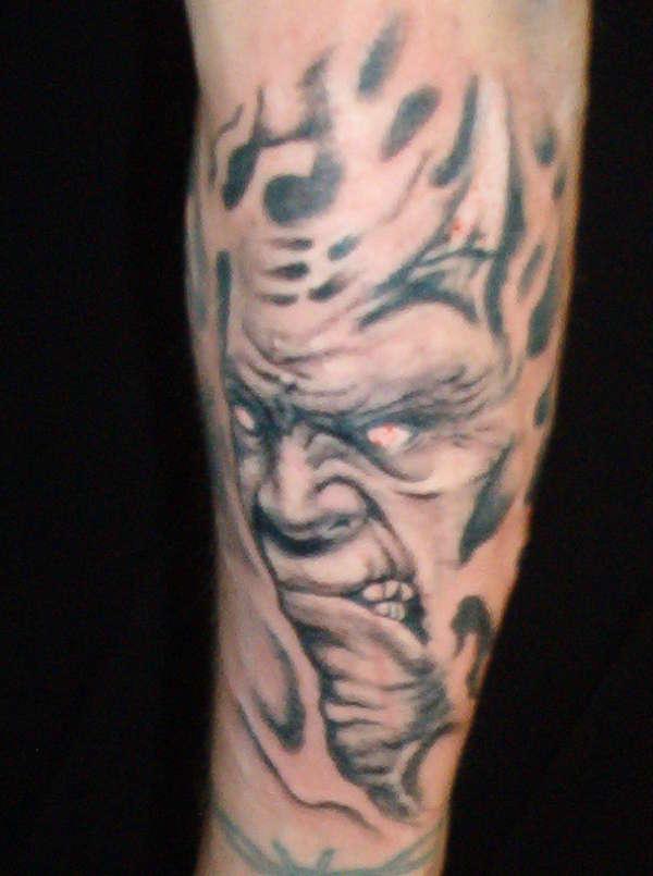 smoke face tattoo