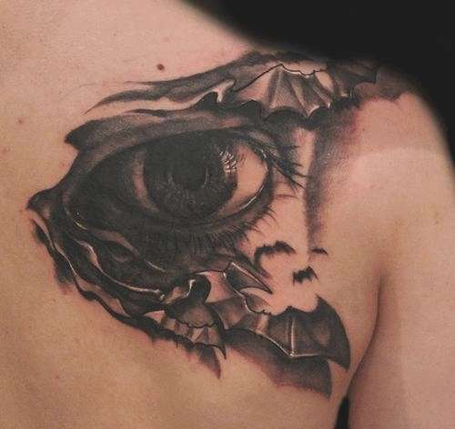 Eye in bats tattoo