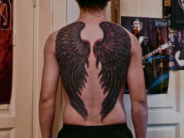 crow wings tattoo