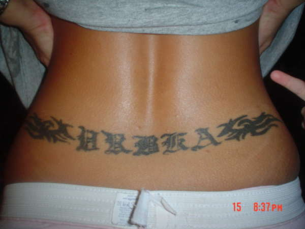 Last name of vrbka with tribal on lower back tattoo for Last name tattoos on back