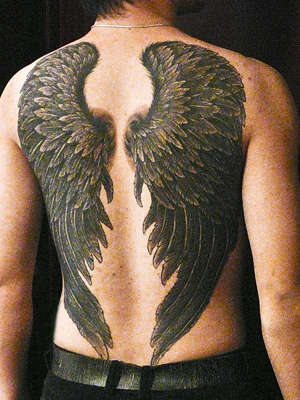 crow wings,healed tattoo