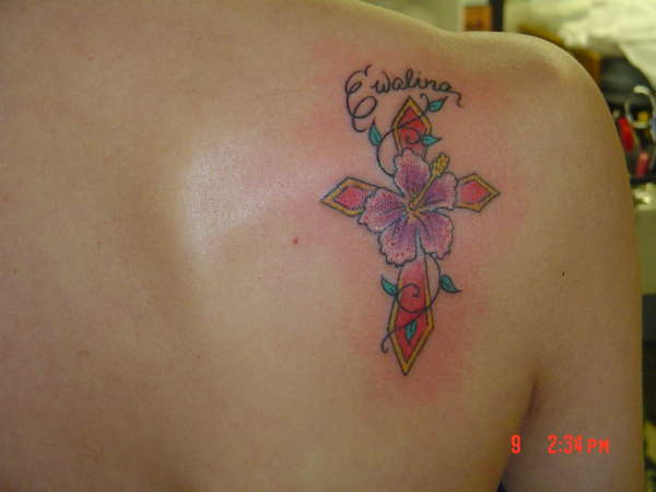 Cross/Hibiscus flower tattoo