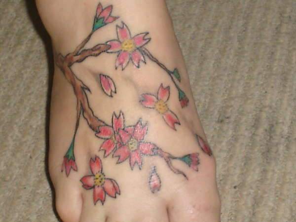 Flowers on foot tattoo