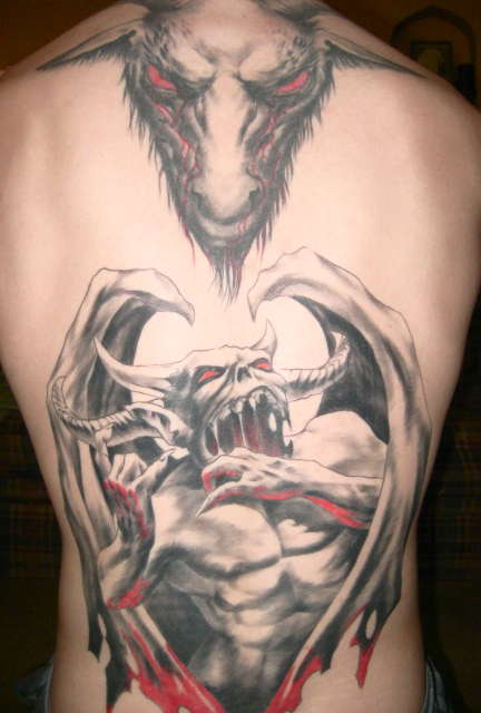 evil back piece tattoo