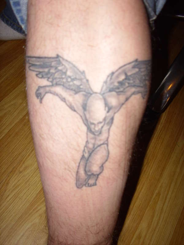 Bald angel tattoo