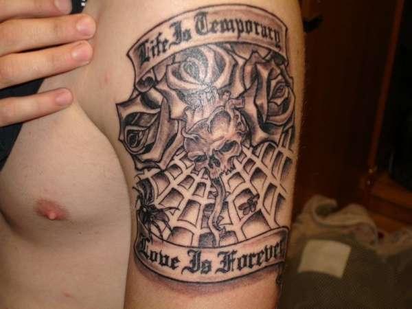 skull heart spider web tattoo