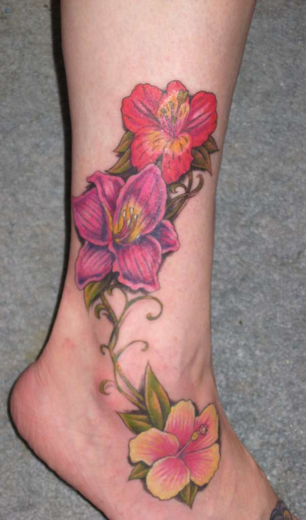 Peruvian lily, lily and hibiscus tattoo