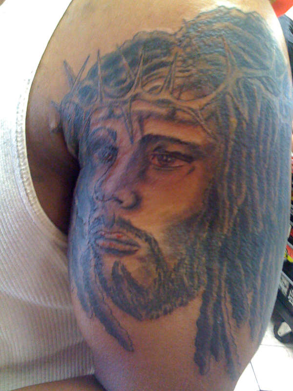 black jesus tattoo