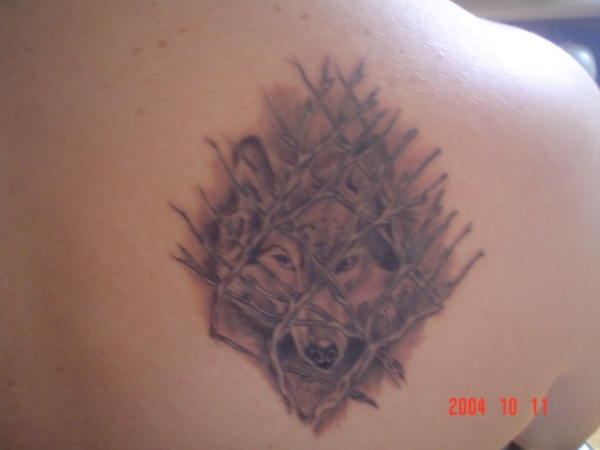 Wolf in Bushes tattoo