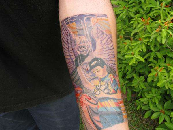 100 mural tattoo amazing sportsman tattoo on back for Back mural tattoos